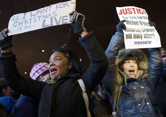 Protestors chant during a demonstration outside the Barclays Center in Brooklyn, N.Y., against a grand jury's decision not to indict the police officer involved in the death of Eric Garner.