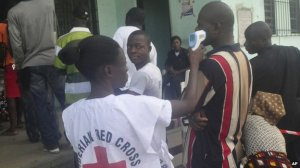 Health workers took the temperatures of voters as a precaution against Ebola