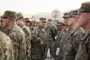 General John Francis Campbell, center, current commander of the International Security Assistance Force and U.S. forces in Afghanistan, speaks to soldiers during a Christmas day visit on forward operating base Gamberi in the Laghman province.