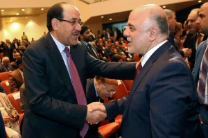 Nouri al-Maliki, left, and Haider al-Abadi meet on Thursday during a parliamentary session in Baghdad to approve the new Government