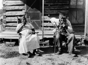 An older couple rest at the end of a workday on a plantation in Tennessee in February 1930. Before the Great Migration of African Americans from the South to the North, the three states with the largest black populations were Georgia, Mississippi and Alabama.