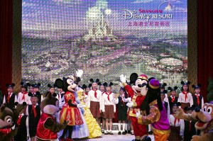 Walt Disney characters perform with children during a celebration held for the start of construction work on Shanghai Disneyland in April 2011.