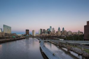 The symbolism of Philadelphia, where the founding fathers overcame broad ideological and regional differences to forge consensus, helped the city prevail over New York and Columbus, Ohio.