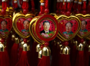 Trinkets depicting President Xi Jinping and Mao Zedong