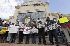 Demonstrators pause for a moment of silence during a protest over the shooting death of Walter Scott in North Charleston, S.C.