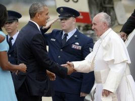 Pope Francis is greeted by U.S. President Barack Obama & First Lady Michelle Obama