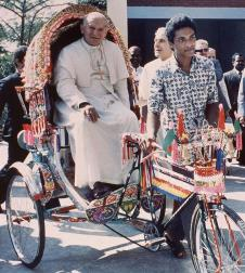 Pope John Paul II rides in a rickshaw during a visit to Dhaka, Bangladesh. November 19, 1986.